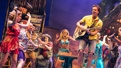 Paul Alexander Nolan as Tully and the cast of Escape to Margaritaville.