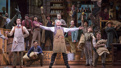 Victor Garber as Horace Vandergelder and the cast of Hello, Dolly!.