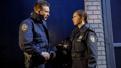 Chris Evans as Bill and Bel Powley as Dawn in Lobby Hero.