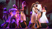 Christie Prades as Gloria Estefan, Mauricio Martinez as Emilio Estefan,  and the company of the national tour of On Your Feet.