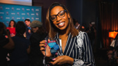 Once On This Island's Hailey Kilgore shows off her award for Favorite Leading Actress in a Musical.