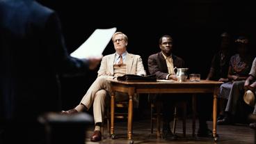 Jeff Daniels as Atticus Finch and Gbenga Akinnagbe as Tom Robinson in To Kill a Mockingbird.