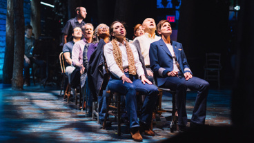 The Come From Away company soars on stage.