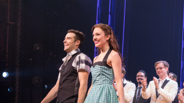 They've got that swing! Bandstand's Corey Cott and Laura Osnes take in the opening night crowd.