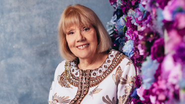 Dame Diana Rigg plays Mrs. Higgins
